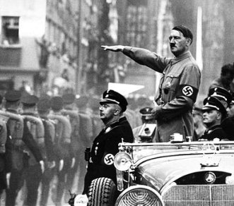 Photo: Adolf Hitler and Heinrich Himmler review SS troops during Reich Party Day ceremonies in Nuremberg, Germany, 1938.